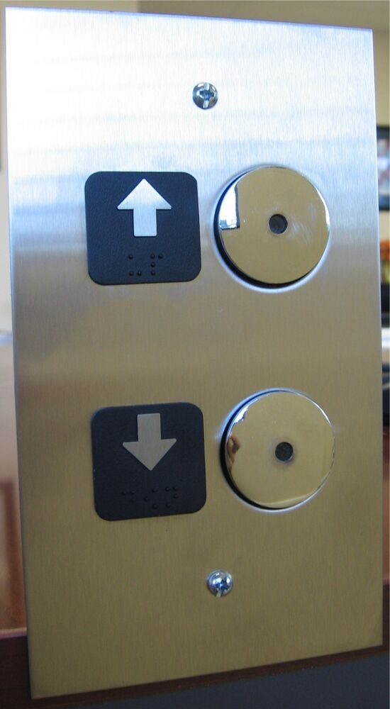 Asians pushing elevator buttons