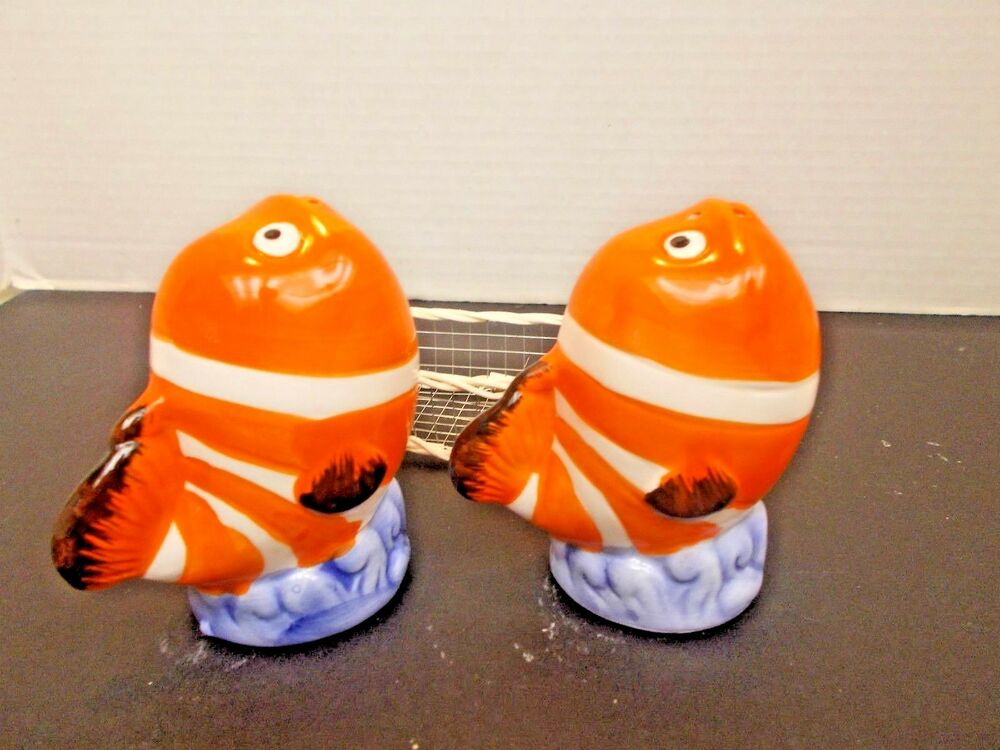 Orange And White Fish Salt And Pepper Shakers In A Basket