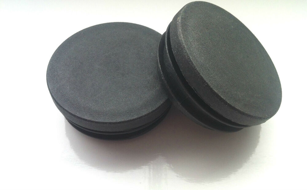Black round plastic blanking end caps and tube inserts