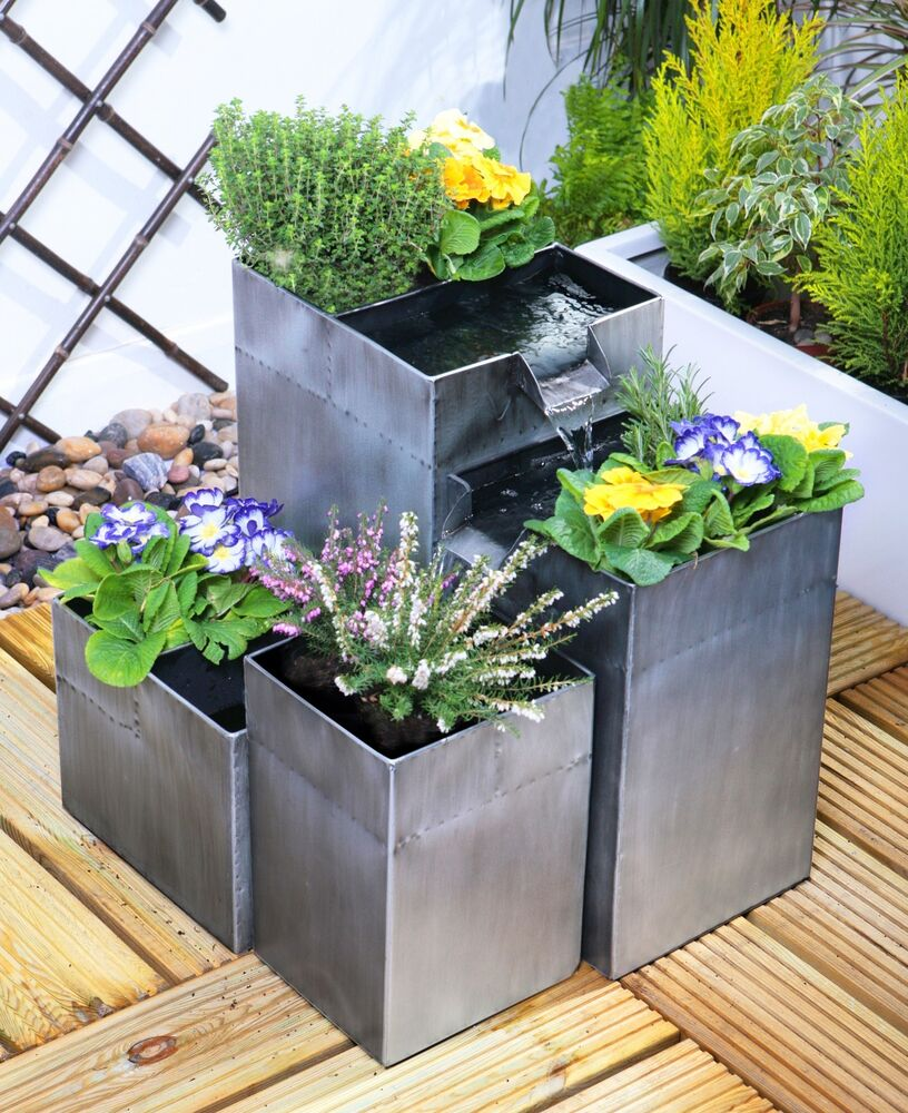 silver planter solar cascade water fountain garden feature. Black Bedroom Furniture Sets. Home Design Ideas
