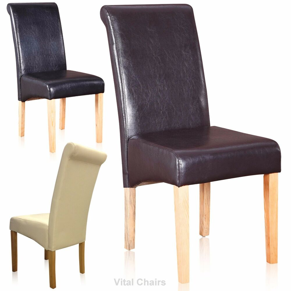 Vital dining chairs faux leather dining room furniture 2 4 for Faux leather dining chairs
