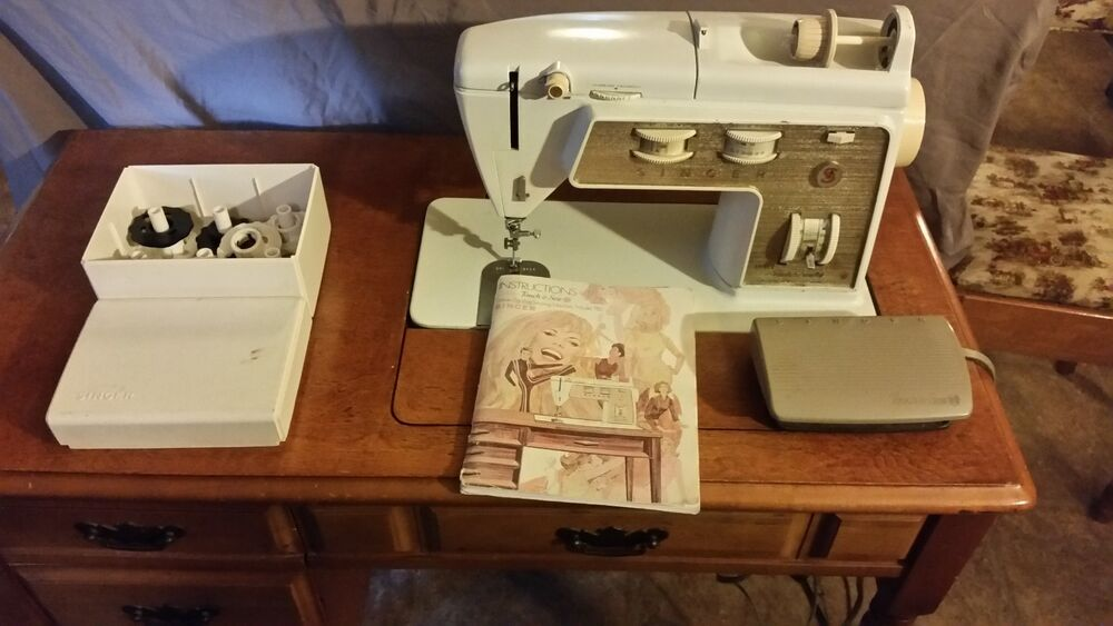 vintage sewing machine with cabinet