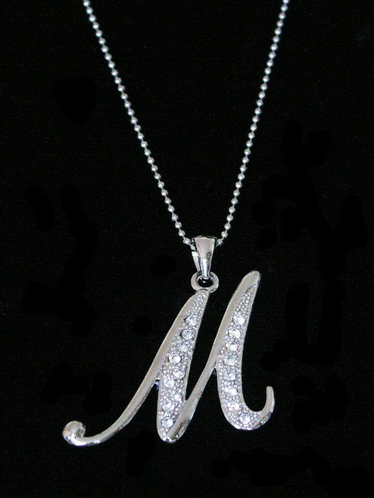 The Nameplate Necklace is a Signature The M piece.. MEASUREMENTS: Available in 16, 18, 20