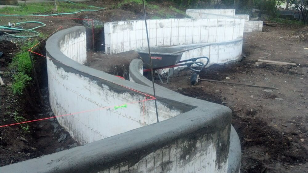 Landscaping walls icf 39 s insulated concrete forms for for Foam basement forms