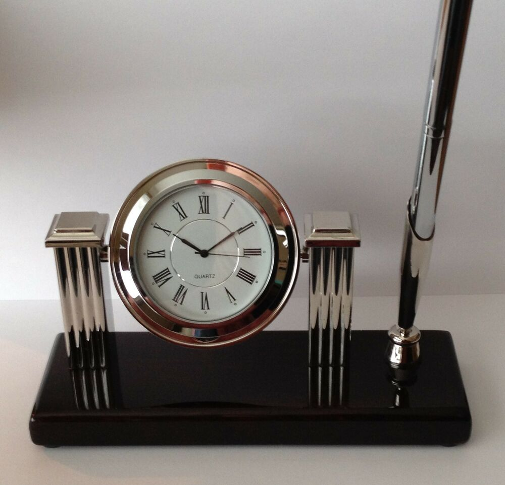 Desk clock with pen silver in color high gloss wood base