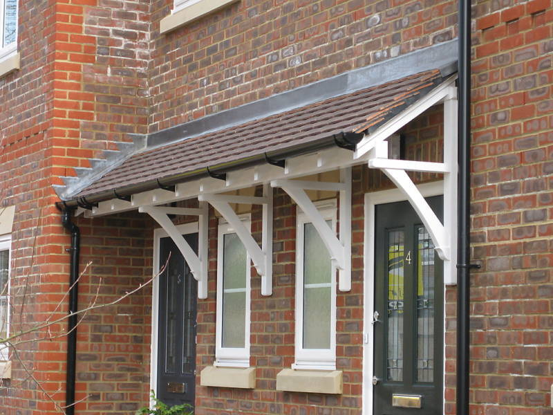 Front door canopies pitched roof porch storm shelter for Front porch roof kits