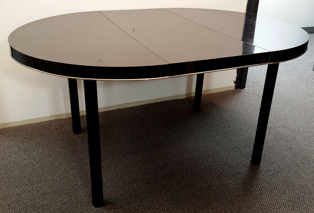 Piano black ebony brass laminate steel legs dining room for Black round dining room table with leaf