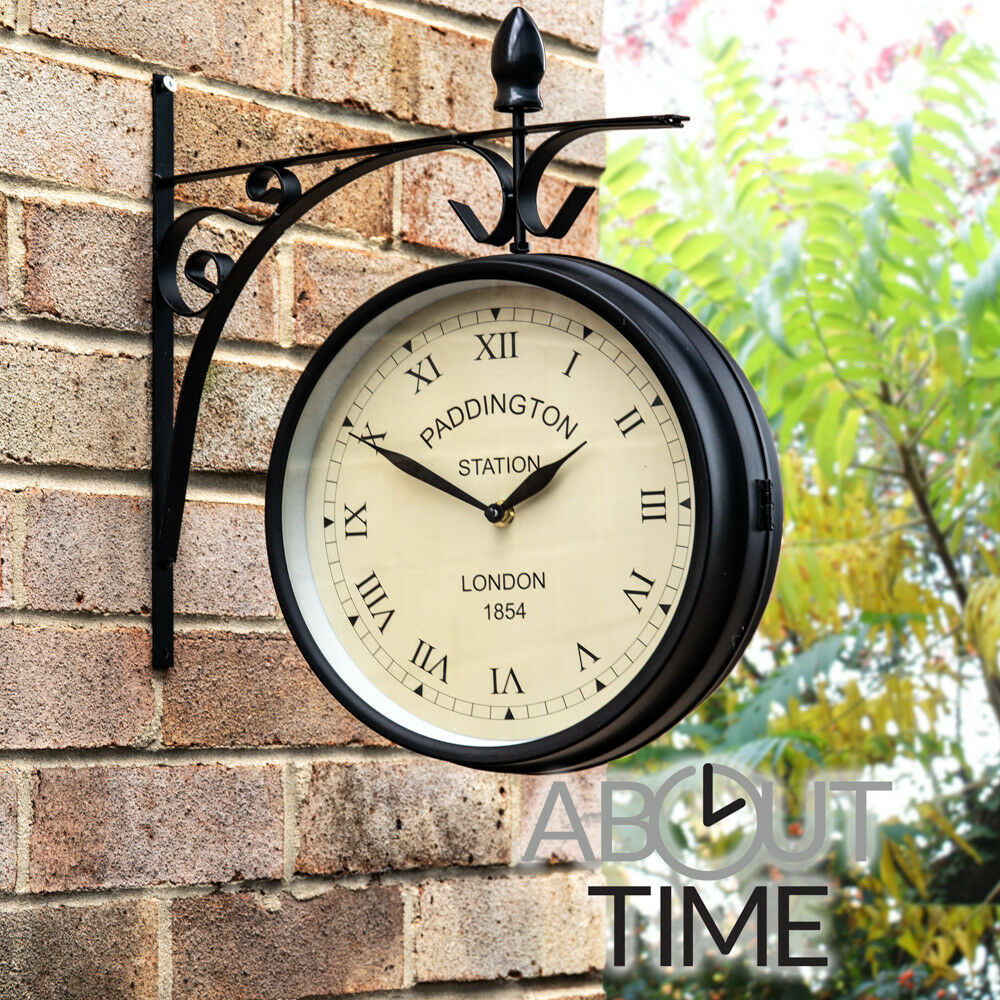 outdoor garden paddington station wall clock outside