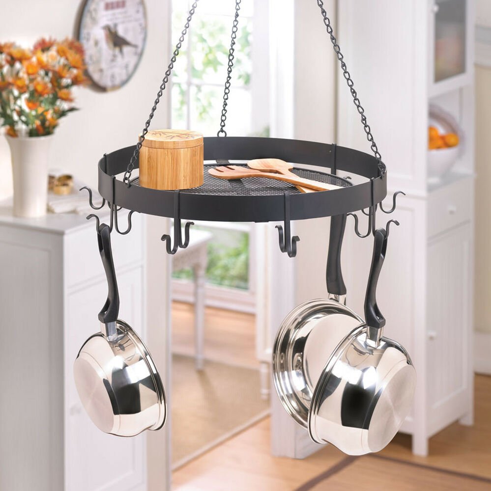 Kitchen circular black iron pots and pans rack with for Kitchen s hooks for pots and pans