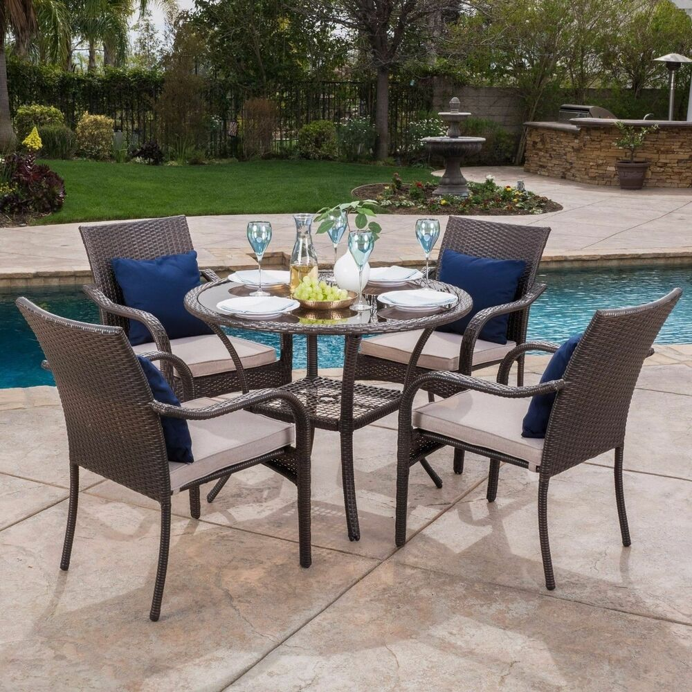 Outdoor brown wicker 5 piece dining set with beige for Outdoor patio dining