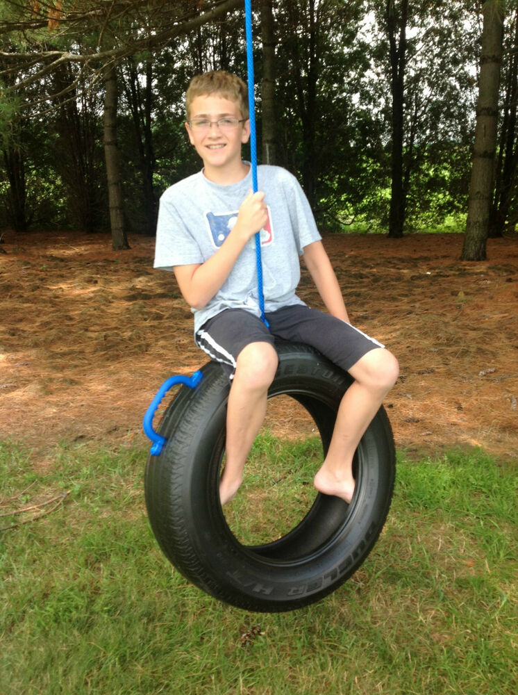 one tire swing made from real recycled tire hang on tree