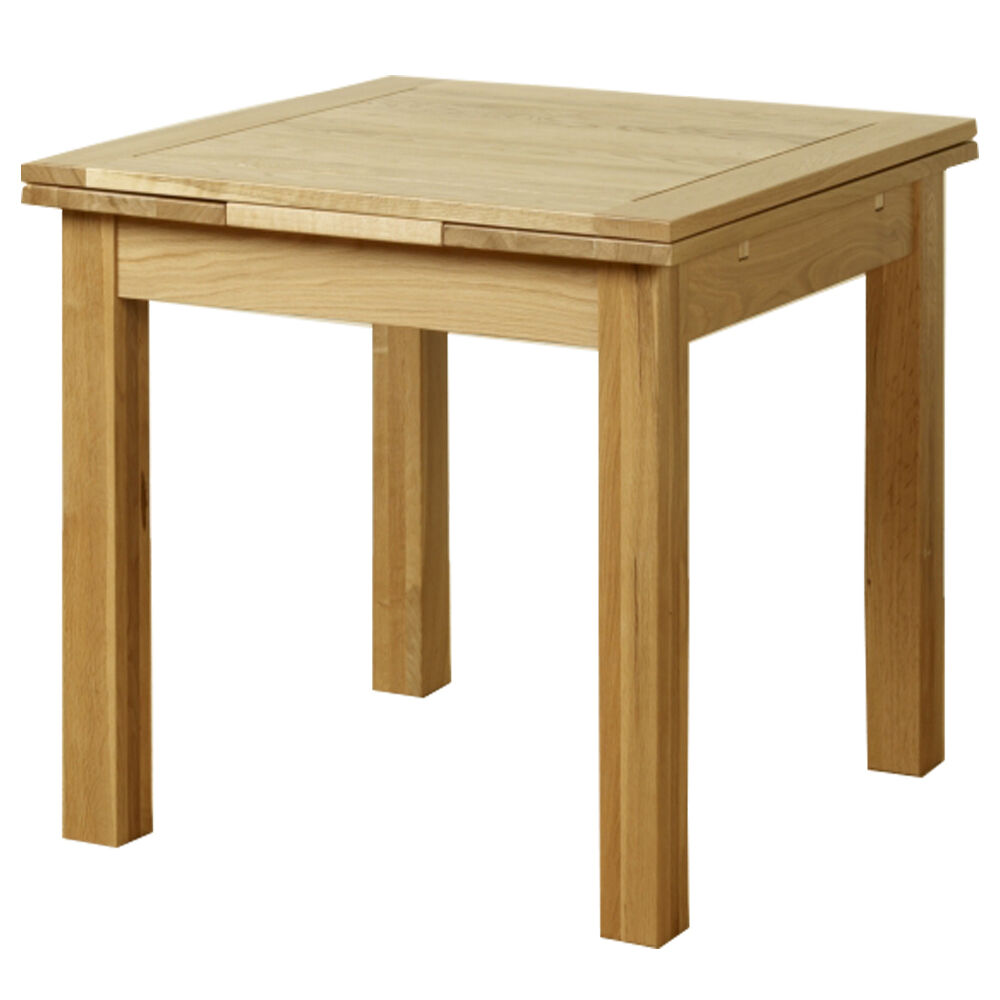 Solid oak extending dining table room furniture extend for Extendable dining table