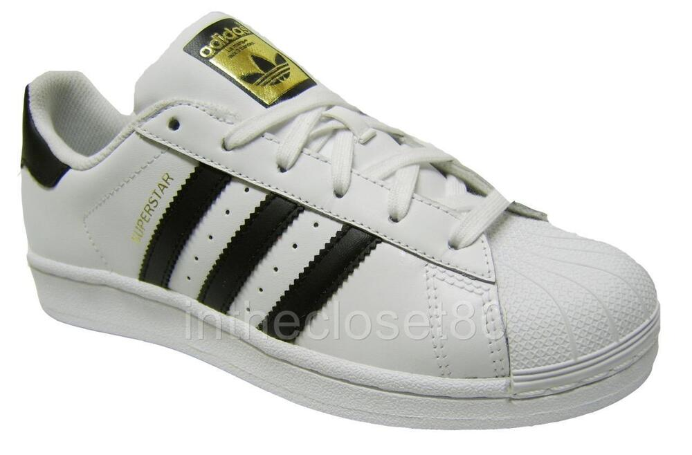 white and black adidas superstar junior
