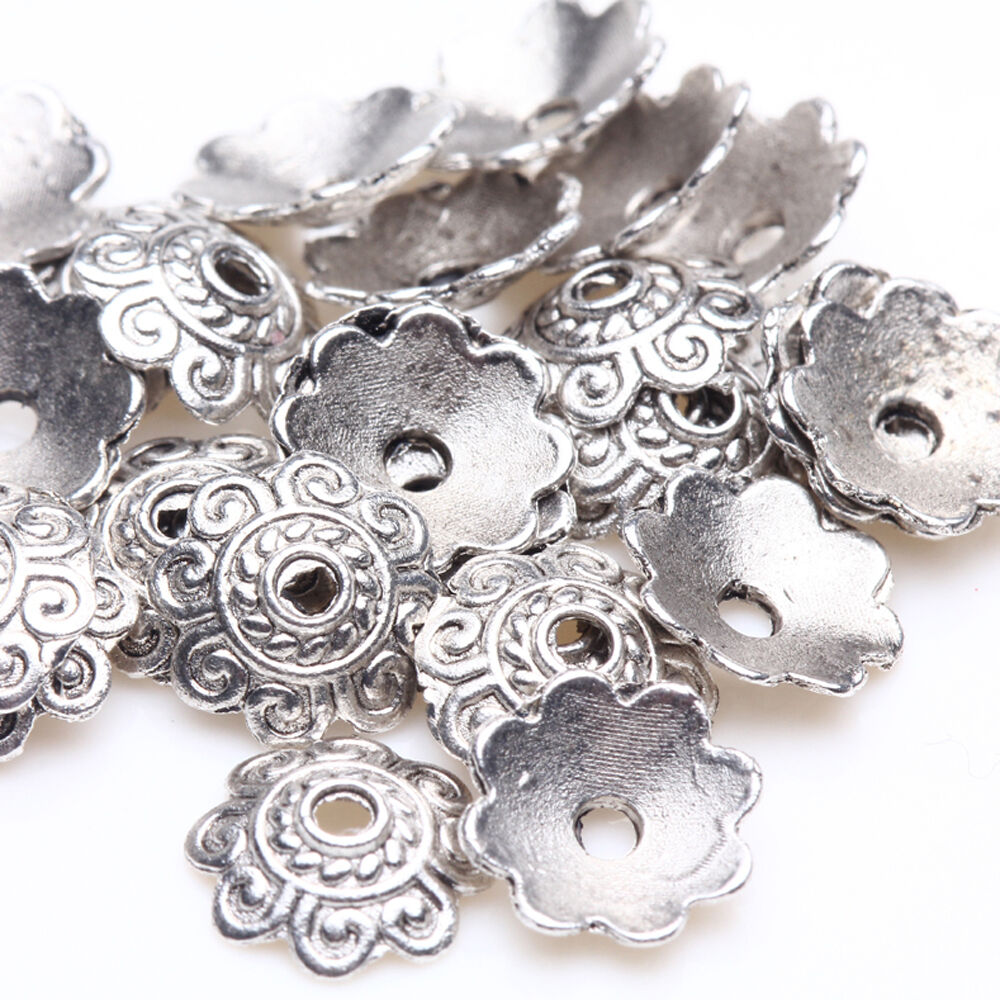 wholesale 100 200pcs tibetan silver carved charms crafts