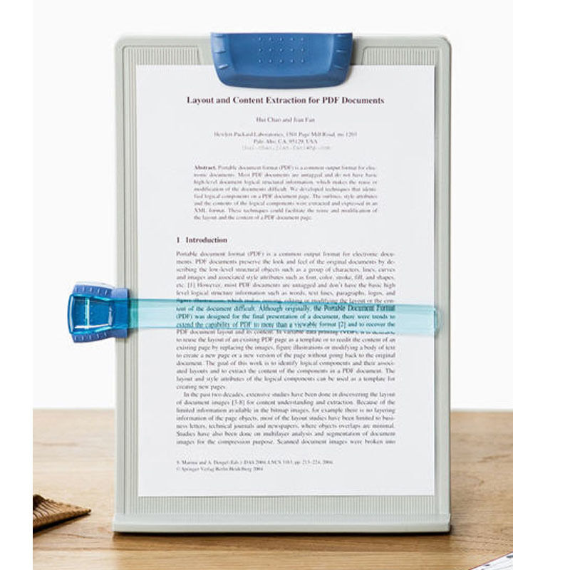 typing paper holder Product features user to position line guide and paper holder along the top or side .