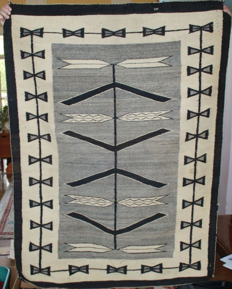 vintage native american rug with owners name woven in arrow  feather pattern