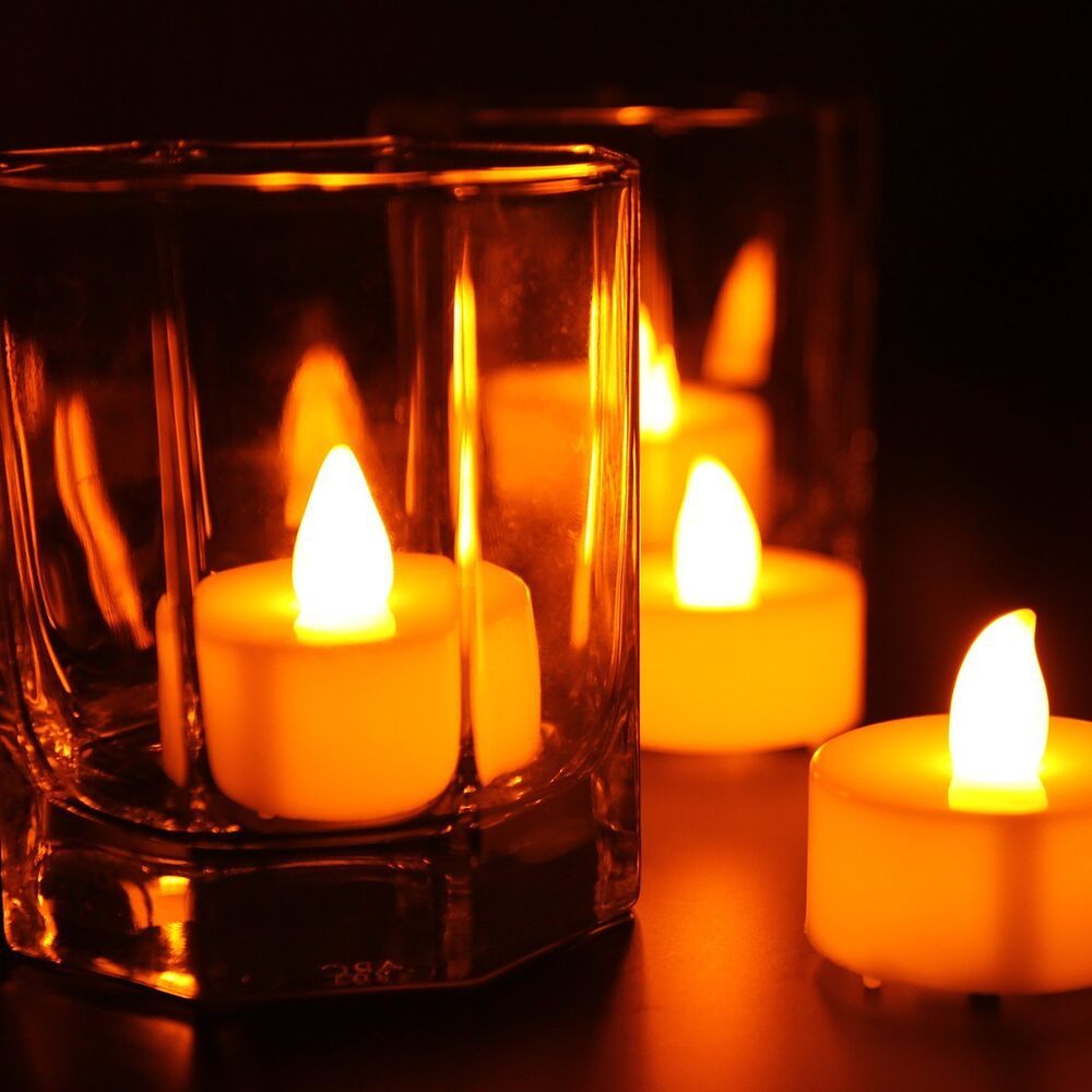 battery operated flickering tea light candles 24 pcs ebay. Black Bedroom Furniture Sets. Home Design Ideas