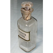 Antique Empty Embossed Upraised Medicated Alcohol Glass Stopper W.T. Co. Bottle