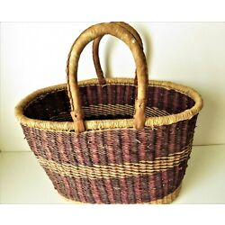Large woven basket with leather handles, 17''x10''x10'' burgundy & natural