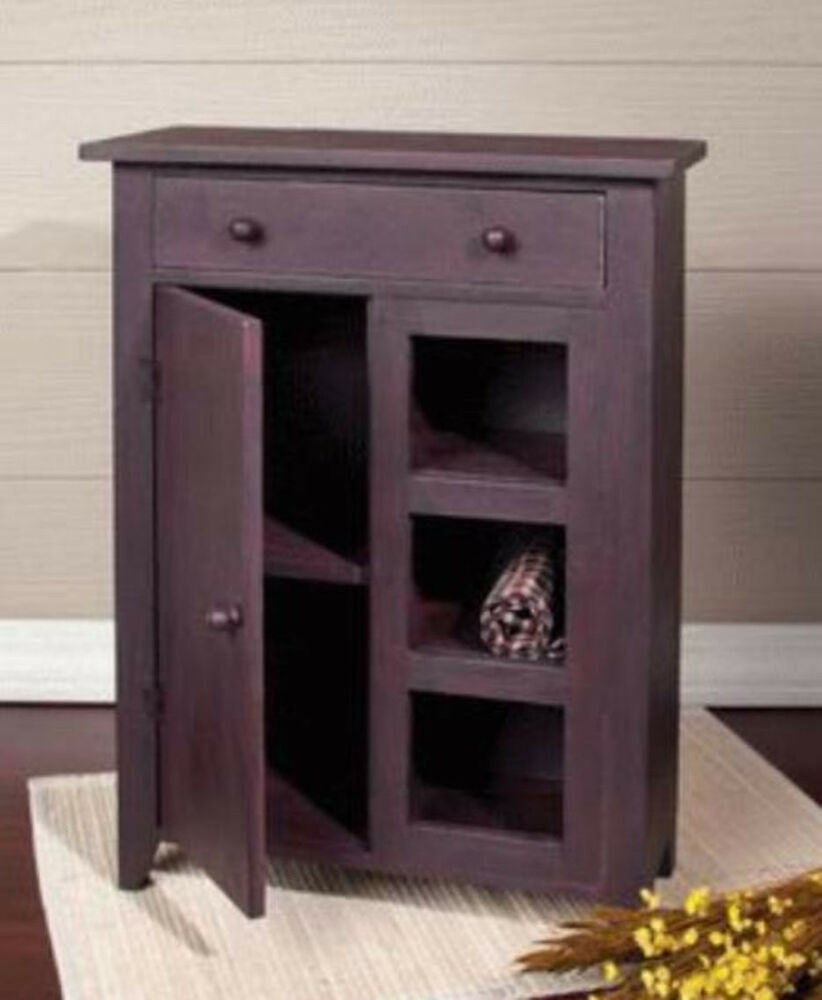 primitive small cabinet door drawer open shelves rust brown black