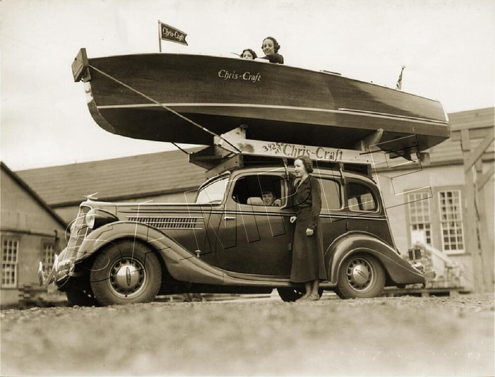 Chris craft boat on top of antique car rare vintage for Classic chris craft boats