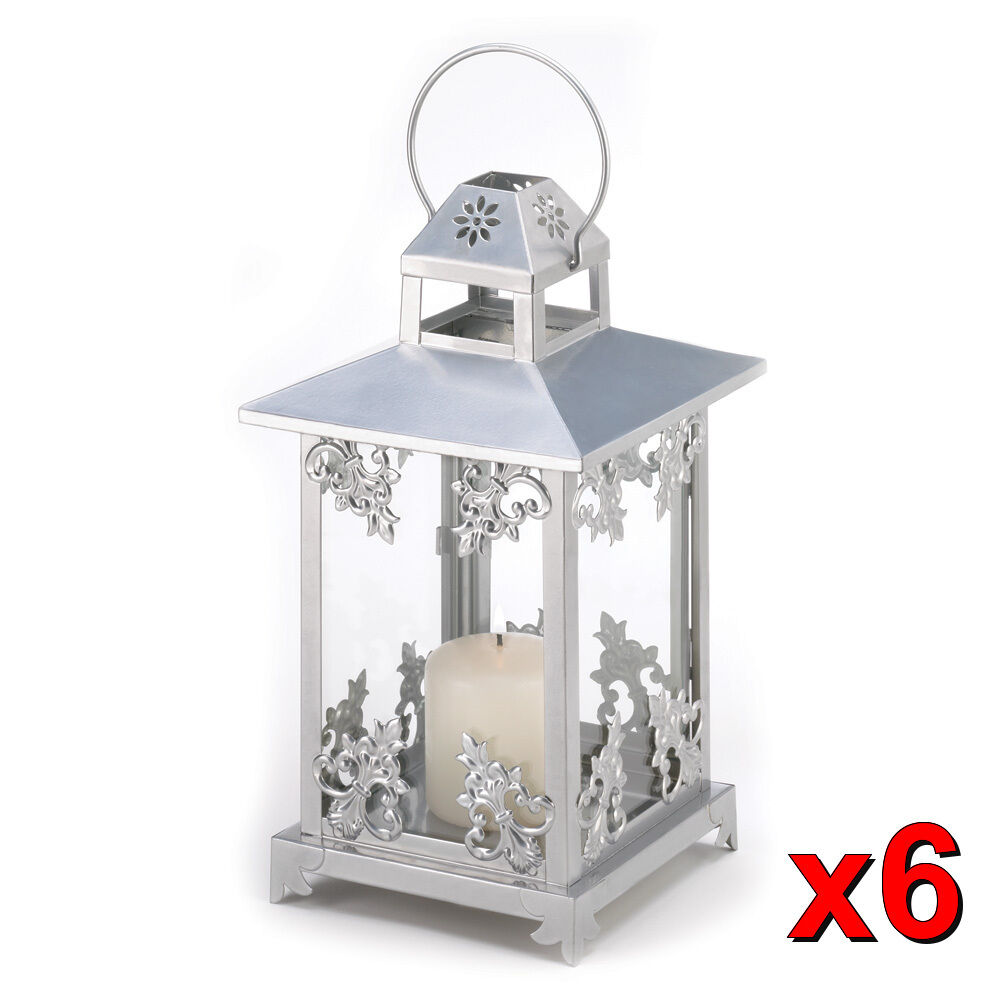 Silver scrollwork candle lantern wedding centerpieces