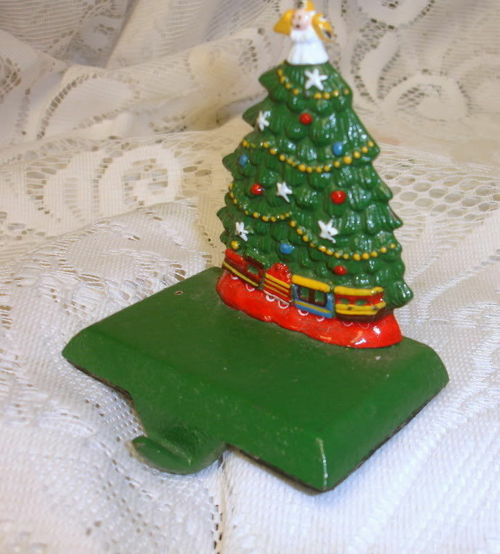Vintage cast iron christmas tree train stocking holder