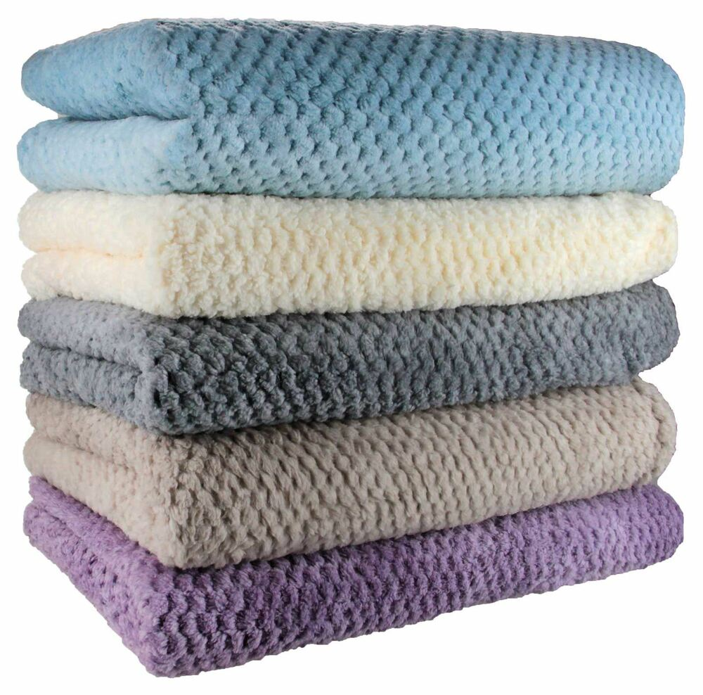 For blankets that get matted down, like faux fur varieties, covered storage like a cedar chest or plastic box with a lid will protect the blanket from losing volume, too. It's best to keep loftier blankets like this in boxes, not vacuum bags, to keep the fabric full.