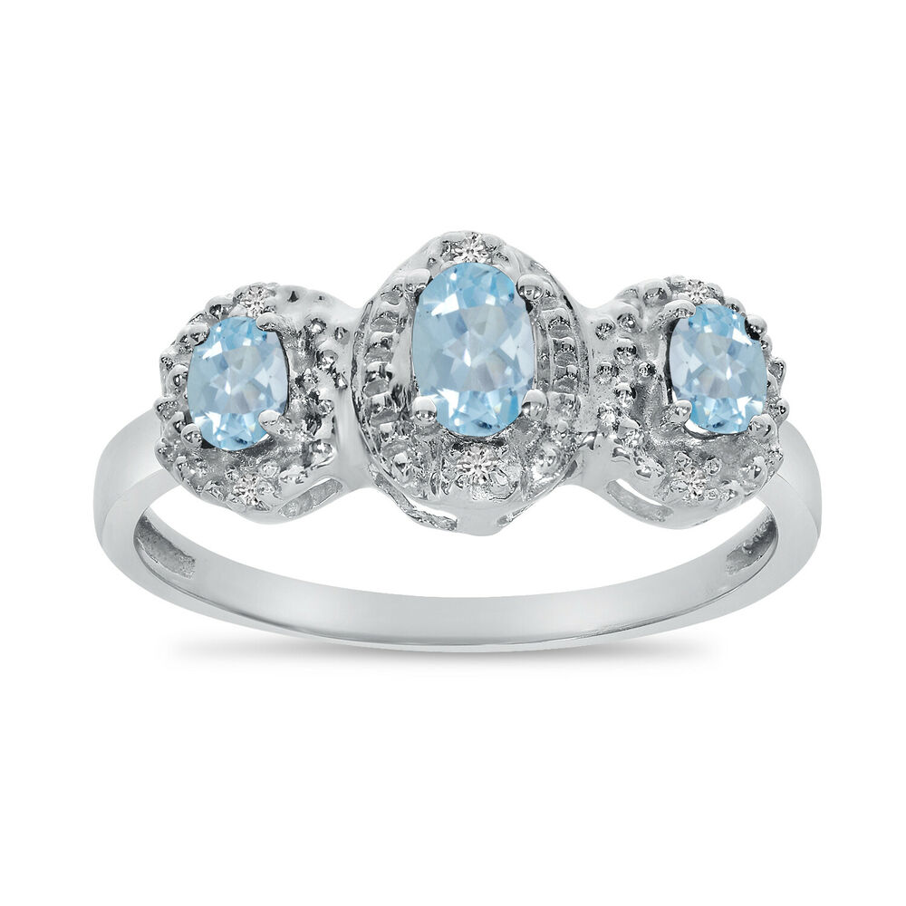 14k White Gold Oval Aquamarine And Diamond Three Stone