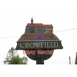 PHOTO  CROWFIELD VILLAGE SIGN (2) UNVEILED BY THE LATE ROY HUDD OBE. IN FEBRUARY