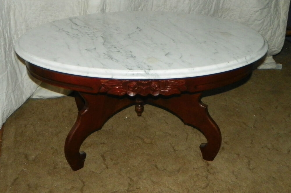 Mahogany rose carved oval marble top coffee table by for Oval coffee table with marble top