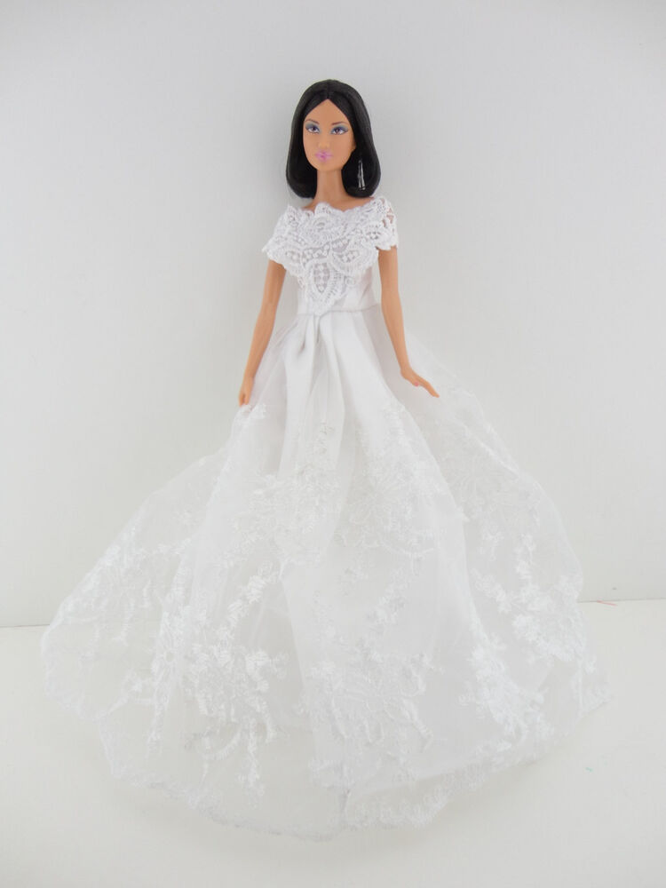 A stunning all white wedding gown with wedding veil made for Wedding dresses for barbie dolls