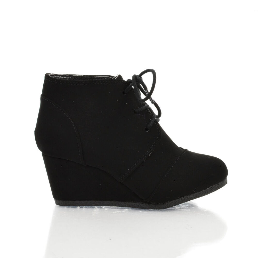 Take a look at some great booties for girls in different styles like tall laced up boots and wedge boots. Tillys carries different brands for the girls like Soda shoes, Dr. Martens, and others. Even the little babies can wear cute VANS kids shoes.
