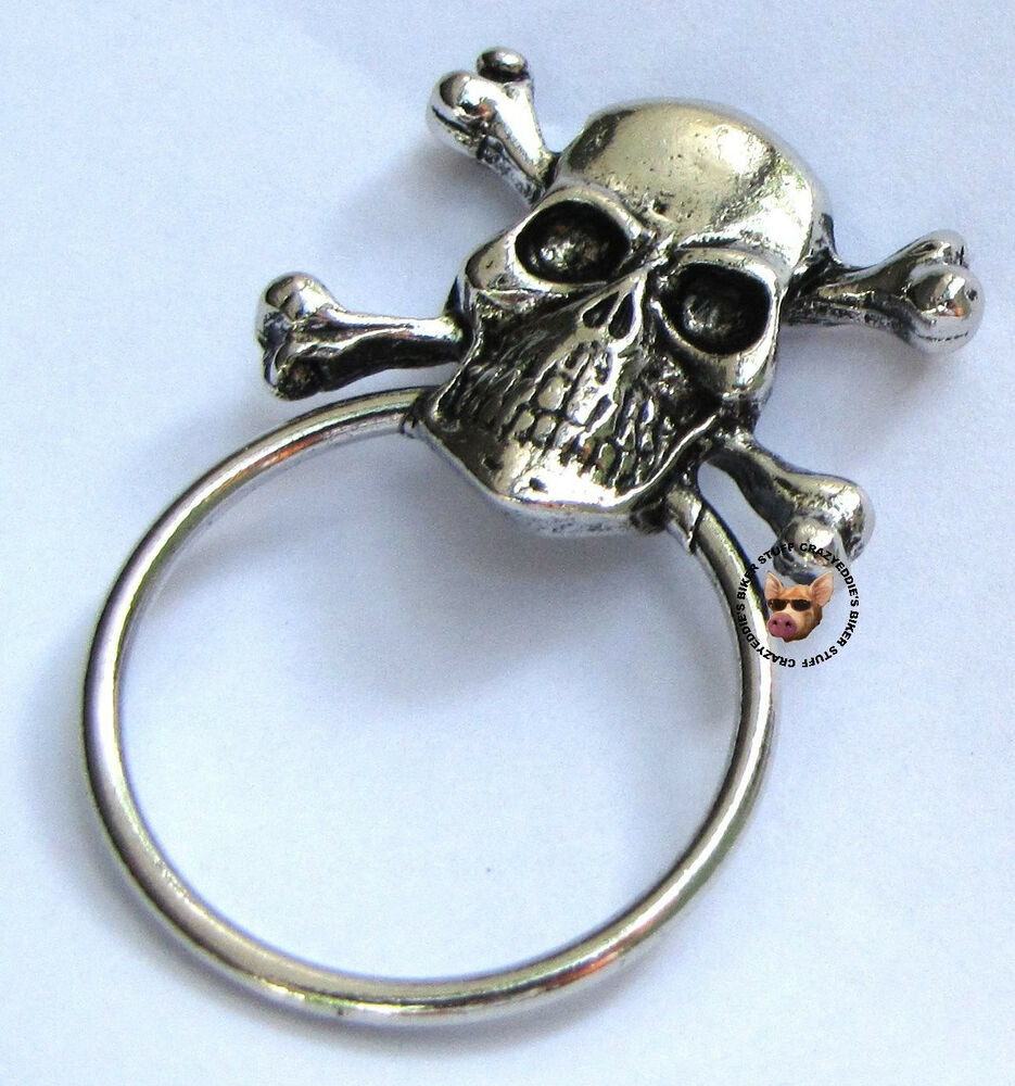 SKULL AND CROSS BONES PIN WITH SUNGLASS HOLDER ** MADE IN