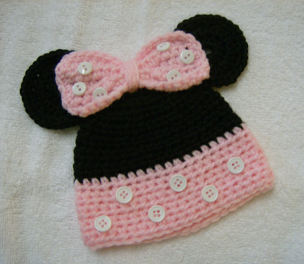 Featuring a cozy and warm Disney's Minnie Mouse kid girls 3 piece winter hat, mittens and glove set. The black knit beanie/hat has a red, white and black pom pom on top with an embroidered Minnie .