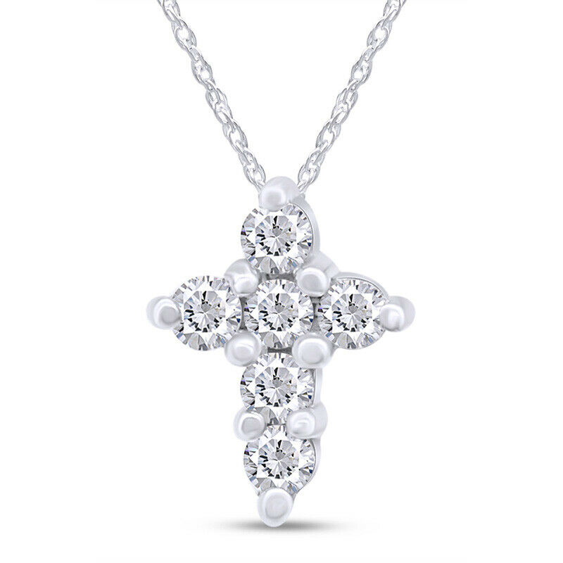 14k white gold prong set tiny diamond cross pendant. Black Bedroom Furniture Sets. Home Design Ideas
