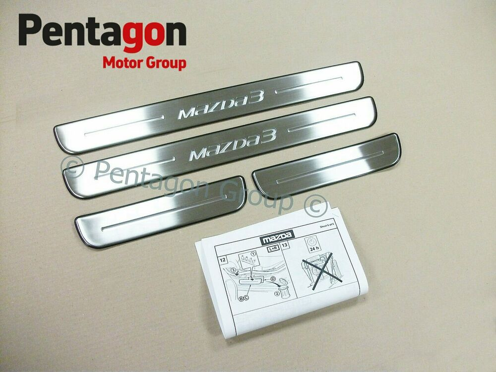 New genuine mazda stainless steel door sill guards