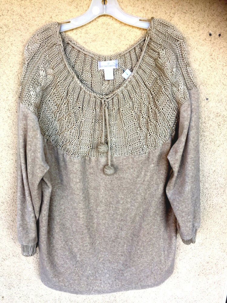 A versatile and elegant addition to your wardrobe, this stylish sweater features flattering scooped neckline and classic cable knit design with a flattering.