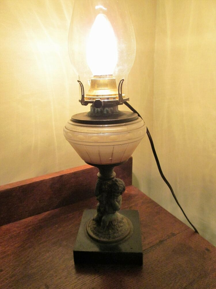Antique Oil Lamp Electricified Pot Metal Cherub Eating