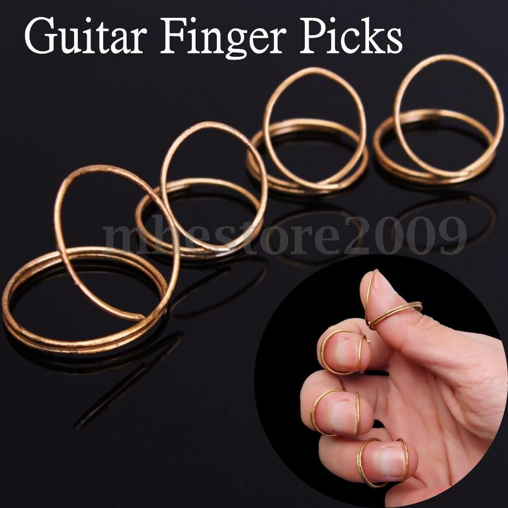 4pcs set gold guitar plectrums finger picks fingerstyle with thumb for guitar ebay. Black Bedroom Furniture Sets. Home Design Ideas