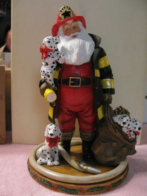 Danbury mint fireman santa with dalmation puppies figurine