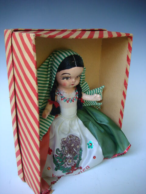 Vintage mexican doll right!