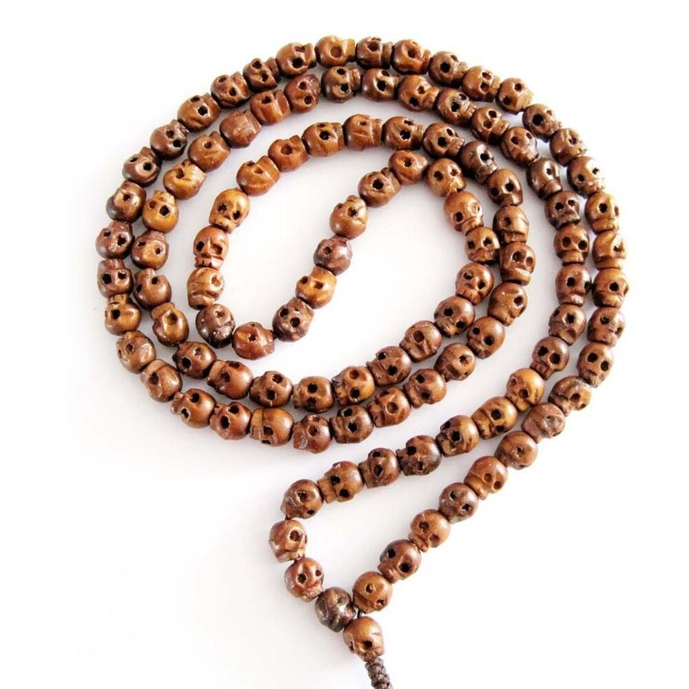 how to hold buddhist prayer beads