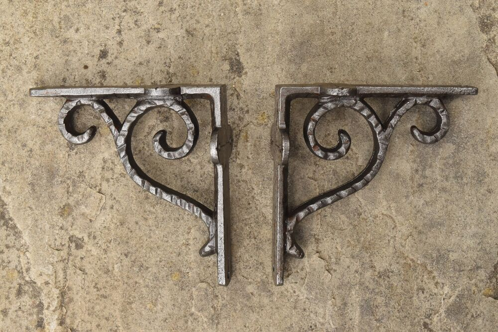 A PAIR OF SMALL CAST IRON HAMMERED ANTIQUE STYLE SHELF