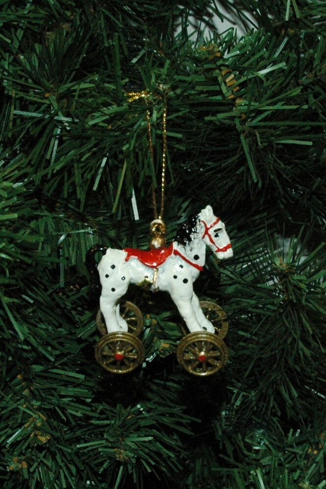 Vingate antique looking metal rolling toy horse christmas