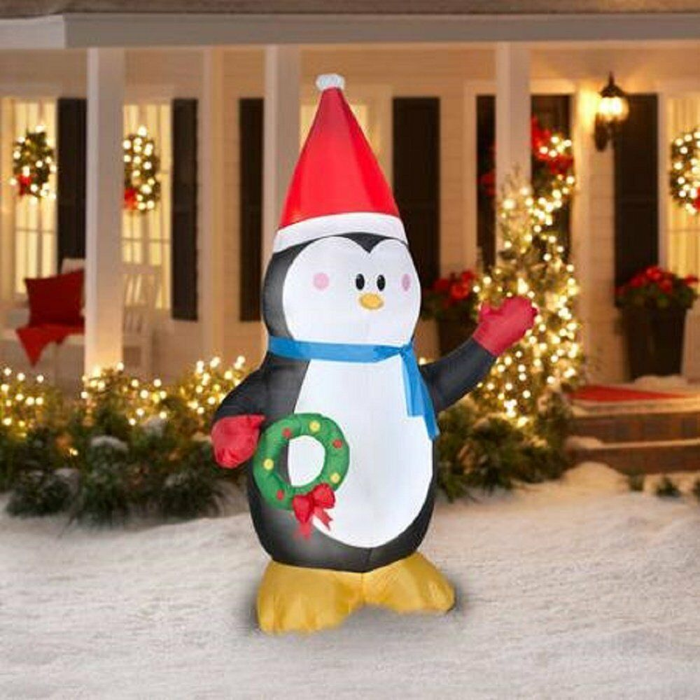 7 ft christmas inflatable penguin w wreath and santa ht for Holiday lawn decorations
