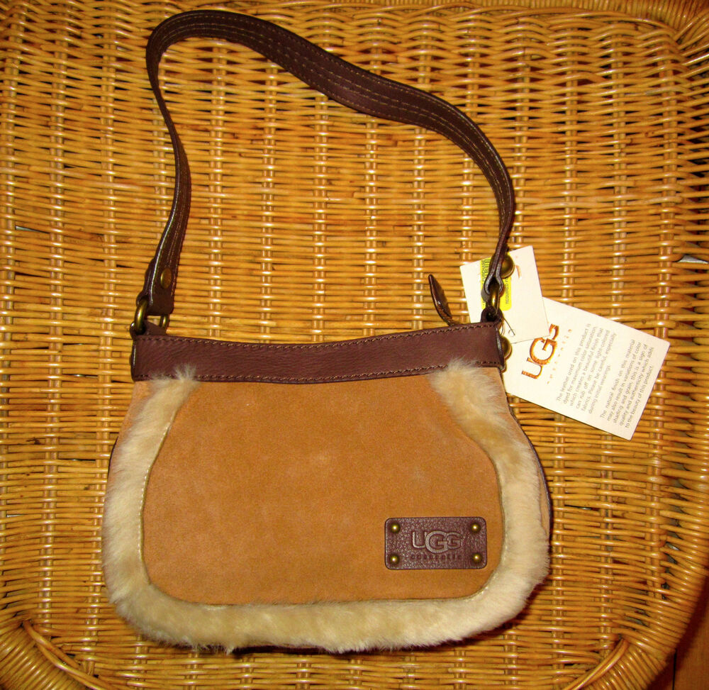 Lovely brown ugg bag I bought it from eBay but have never used it The coating is peeling off on the toes but otherwise in good used condition. Ladies Ugg Cross Body Sheepskin Bag. £ 0 bids + £ P&P. Lovely little cross body bag, big enough for your phone keys and .
