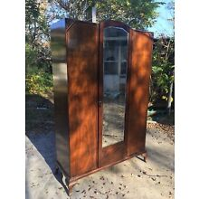 Vintage Wood Armoire With A Centered Mirror