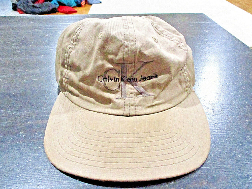 abad5e85fa5 Details about VINTAGE Calvin Klein Jeans Snap Back Hat Cap Brown Tan CK  Spell Out Mens 90s