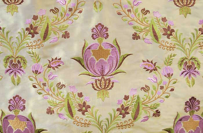 Embroidered shot silk fabric iridescent gold with rose